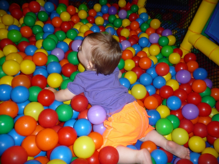 He launches himself into ball pits.