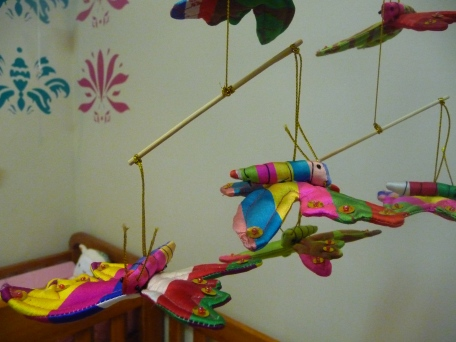 I prefer not to have noisy flashing cot mobiles but I love this mobile of silk butterflies from Cambodia.  Handed down from Theo.  Give it a spin and the butterflies will dance over sleepy baby, lulling her to sleep.