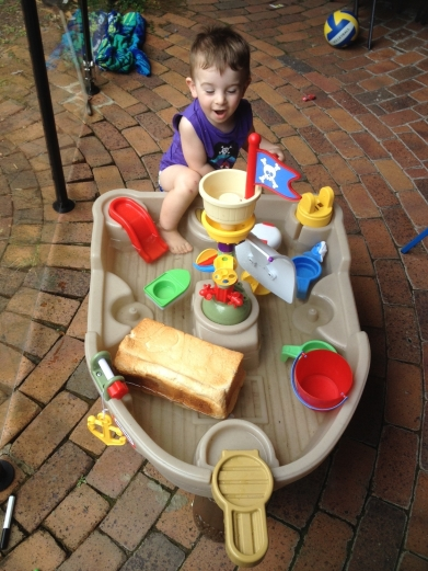 T plays with a loaf of bread in the pirate ship.  Because that's where bread goes apparently.